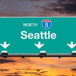 Seattle Interstate 5 north highway sign with sunrise sky.